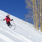 Carly making some turns on a bluebird day.