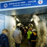 At the station at the top.  The tunnel bores through the peak and to a bridge between the two pinnacles that make up the Aiguille du Midi.