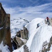 Amazing terrain on the Cosmiques Arete.  Mont Blanc the rounded dome in the far center.