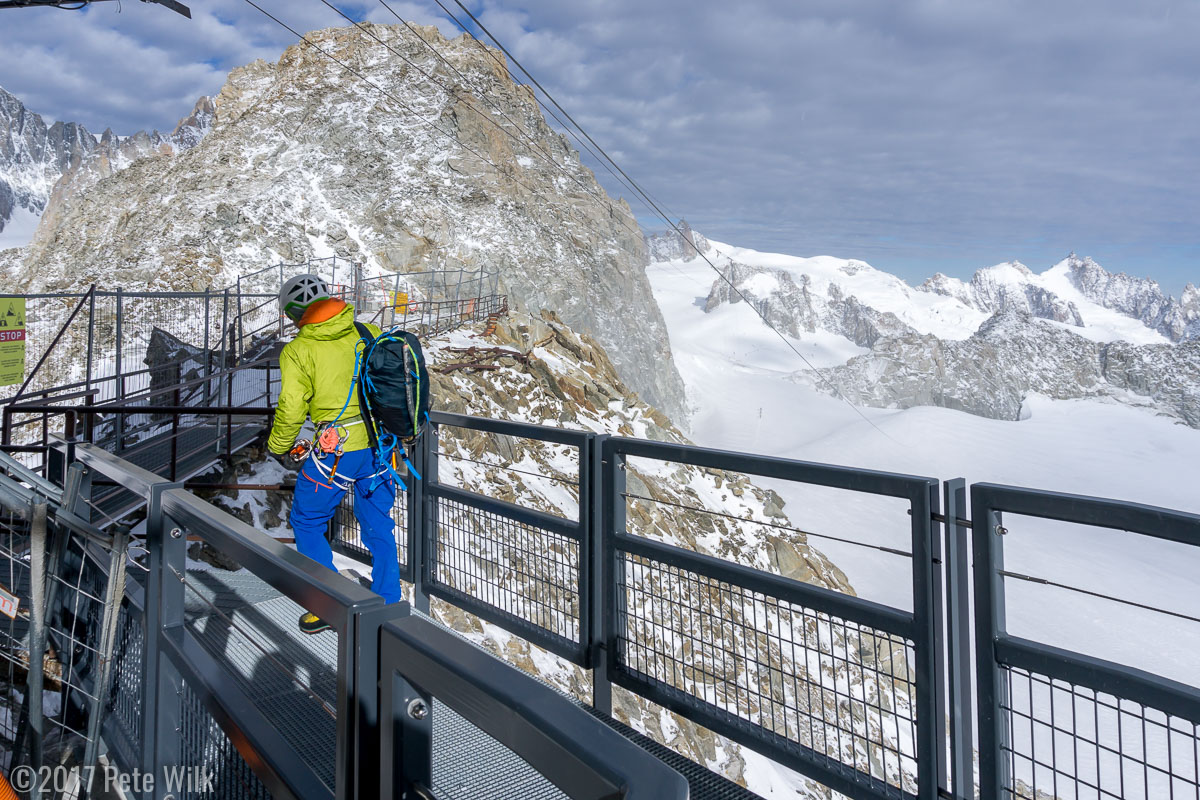 Maxime leading the way out of the Italian Skyway telepherique.  The Aiguille du Midi is across the glaciers in the distance.  The cables for the Helbronner go across to that side without supports.