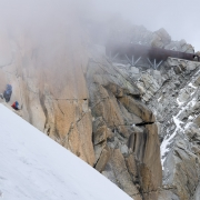 The beginnings of the turn in weather and in fluidity of the climbing.  The Russian team of three is about to create a traffic jam.  Note that there\'s still a fair amount of climbing before getting to the platform.