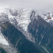 An empty Brevent cable car going back down to the midstation at the Planpraz.  The Aiguille du Midi side is across the valley.