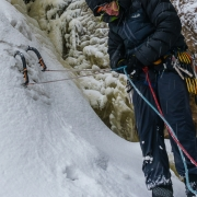 Chris gearing up to lead some steep ice.