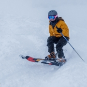 Carly ripping it through the powder on Christmas Day at Snowbird.