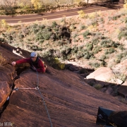 The money second pitch starts as unprotected 5.7 slab and moves to a technical face with spaced bolts.  A finger crack begins after the face and turns quickly into a hand and fist crack.  It is 170 ft of great climbing that I need to go back to do.