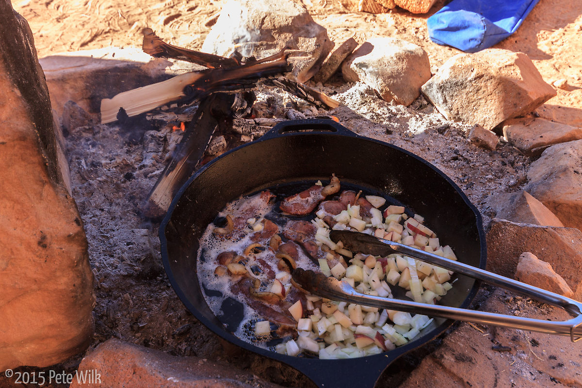 Cooking breakfast like the coyboys did.  A NO match fire as there were still some coals from the previous night.