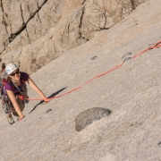 Carly making her way up the last few feet of the slab pitch.