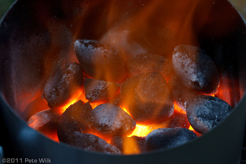 Charcoal firing up for steaks.