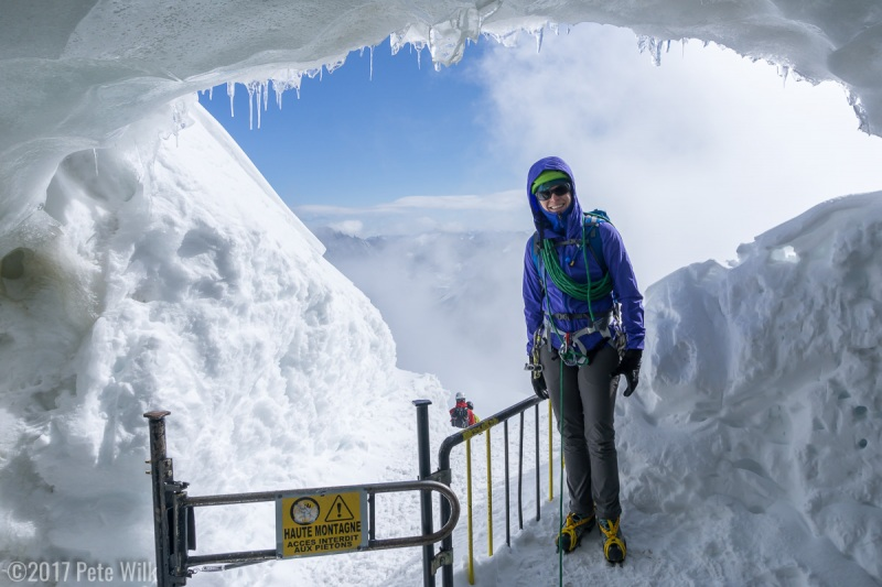Carly at the mouth of the ice cave that leads down the infamous knife edge snow/ice ridge from the Aiguille du Midi.