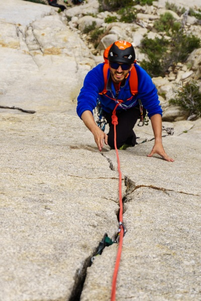 Giovanni going up the great finger crack on Racing Lizards (5.7).