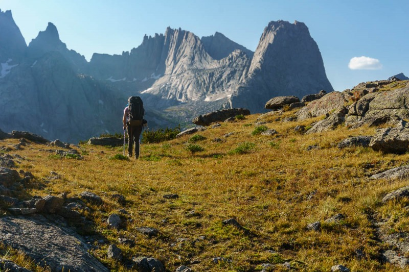 Almost there.  Topping out Jackass Pass with Pingora and Wolf\'s Head in the late day sun.