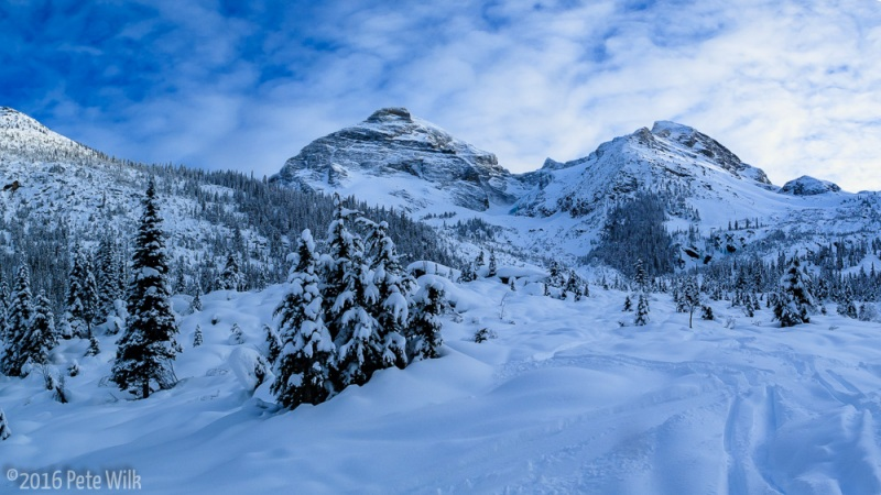 View of Mt. Sir Donald (left of center), and Perly Rock (well right).  Our ski line was from just off frame to the right, down to the right of the icy cliff band capped by 4 large pines.