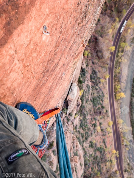 Looking down from the P6 hanging belay.  Our bivy is in the space behind the large pinnacle below me.