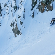 Snowboarder dropping into the Cirque.