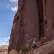 Carly give the lead end of the rope a try on an unnamed 5.10.