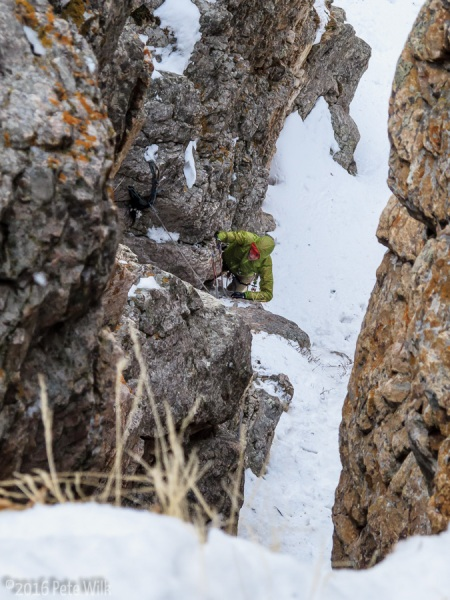 Matt going up the first steeper section of our P2.  There are chains on skier\'s left.