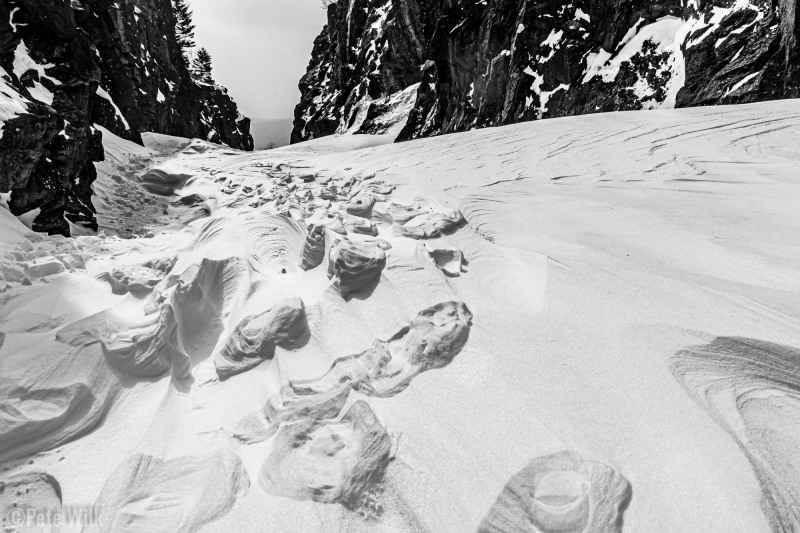 Interesting snow patterns near Crawford Notch.  Footprints compressing the snow later had the surrounding snow erroded by the wind.