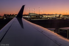Sitting on the plane watching the alpenglow at Logan Airport.