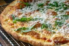 We've got a new pizza dough recipe and it is amazing.  Another trick we've learned is getting the stone almost all the way to the top of the oven.