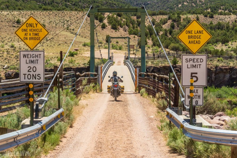 Andreas riding over the narrow Swinging Bridge.  I can't imagine too many high clearance vehicles narrow enough to get over the bridge to the road on the other side.