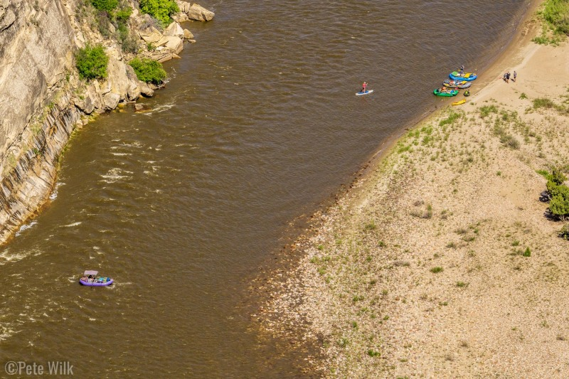 Looking down from high on the rim to rafters floating the Yampa River.