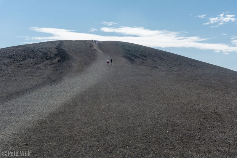 The trail up the cinder cone.  The whole pile is basically made of pea and marble sized rocks.  It formed when a fountain of magma sprayed into the air and this is the cooled and hardened magma.