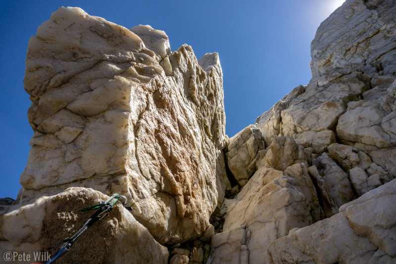 This route ascends a massive vein of quartz on the apply named Crystal Crag.
